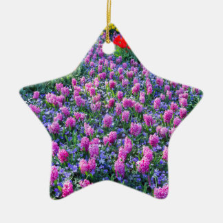 Field of pink hyacinths and red tulips ceramic star ornament