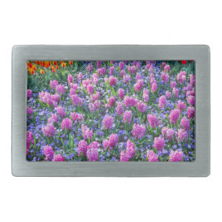 Field of pink hyacinths and red tulips rectangular belt buckle