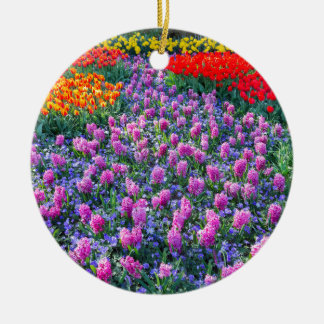 Field of pink hyacinths and red tulips round ceramic ornament