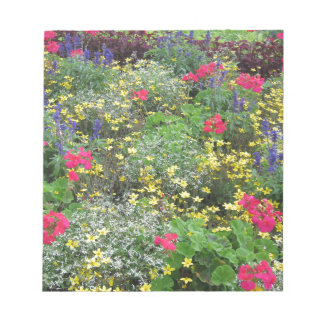 Field of spring flowers in bloom notepads