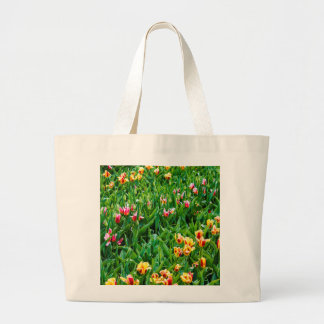 Field with Pink and Yellow Tulips Large Tote Bag