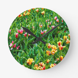 Field with Pink and Yellow Tulips Round Clock