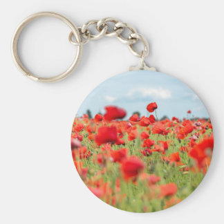 Field with red papavers keychain