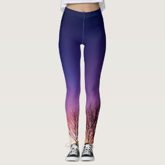 Fiery winter sunset with line of bare trees leggings