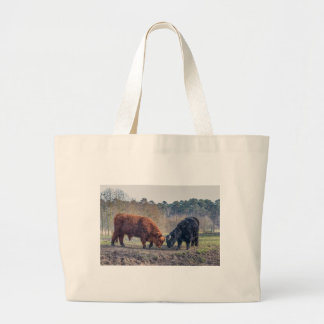 Fighting black and brown scottisch highlander bull large tote bag