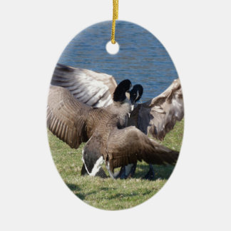 fighting geese ceramic oval ornament