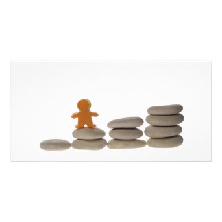 Figurine on stack of pebbles picture card