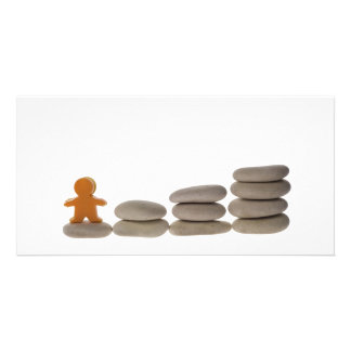 Figurine on stack of pebbles photo cards