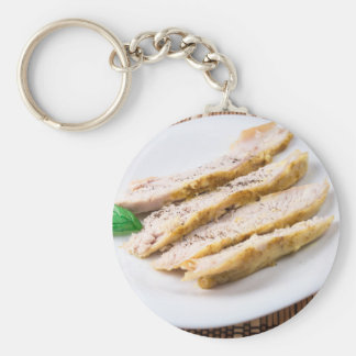 Fillets cut into pieces of baked chicken basic round button keychain
