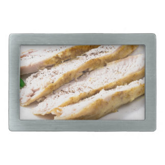 Fillets cut into pieces of baked chicken belt buckles