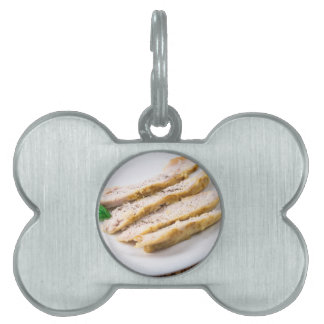 Fillets cut into pieces of baked chicken pet name tag
