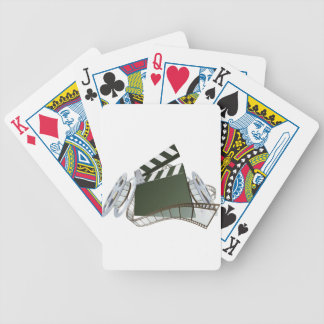 Film clapperboard and movie film reels poker cards