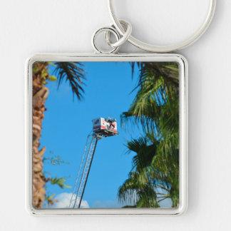 fire truck ladder against sky framed palm trees key chain