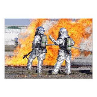 Firefighters battle a simulated fire photograph