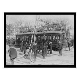 Firemen With Their Hoses Over a Streetcar 1912 Poster