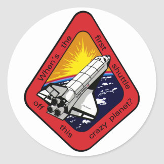 First shuttle off crazy planet? round sticker