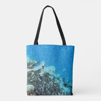 Fish moving over the reef tote bag