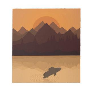 Fish on lake notepad