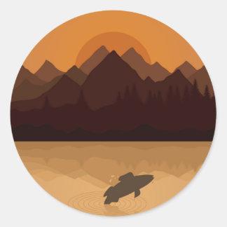Fish on lake round sticker