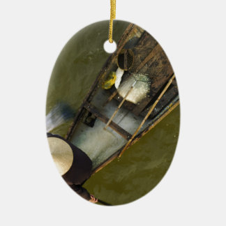 Fisher in Asia from above Ceramic Oval Ornament