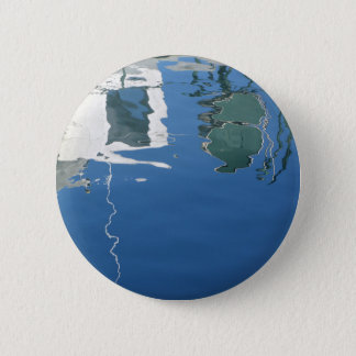 Fishing boat reflects in the water 2 inch round button