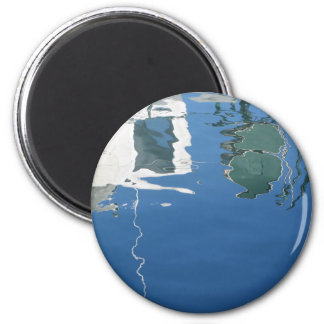 Fishing boat reflects in the water 2 inch round magnet