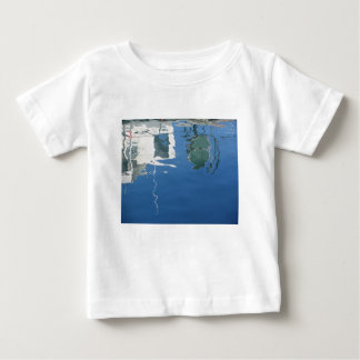 Fishing boat reflects in the water baby T-Shirt