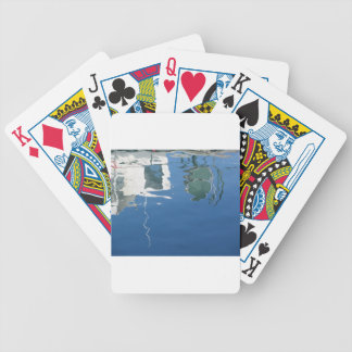 Fishing boat reflects in the water bicycle playing cards