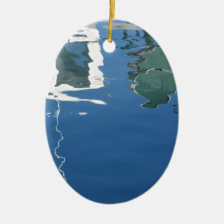 Fishing boat reflects in the water ceramic ornament