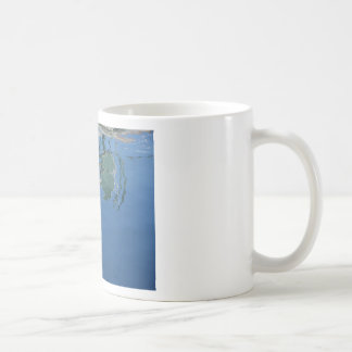 Fishing boat reflects in the water coffee mug