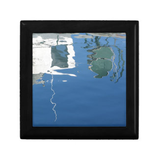 Fishing boat reflects in the water keepsake box