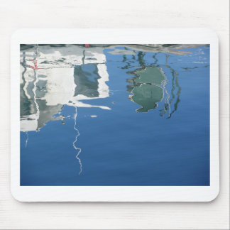 Fishing boat reflects in the water mouse pad