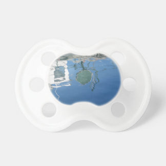 Fishing boat reflects in the water pacifier