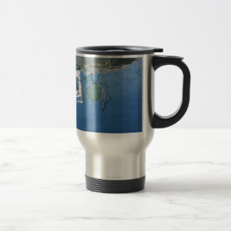 Fishing boat reflects in the water travel mug