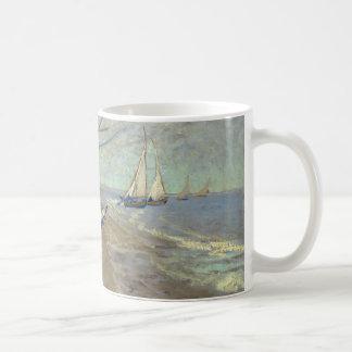 Fishing boats on the beach basic white mug