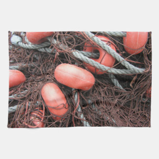 Fishing nets, floats and rope on the harbor kitchen towel
