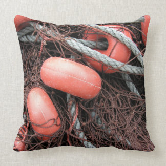 Fishing nets, floats and rope on the harbor throw pillows