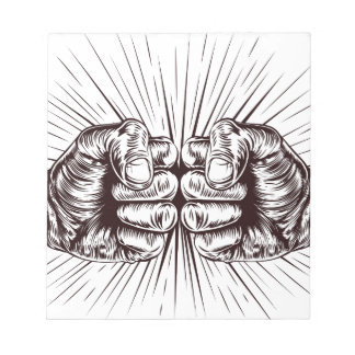 Fists punching notepad
