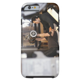 fitness coach works with 'senior' in gym tough iPhone 6 case