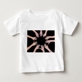 Five children hands joining in circle above black baby T-Shirt