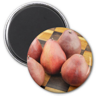 Five Red Pears on a Wooden Chessboard 2 Inch Round Magnet