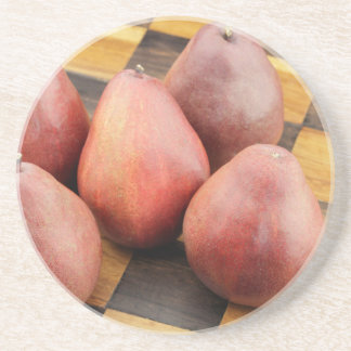 Five Red Pears on a Wooden Chessboard Coaster