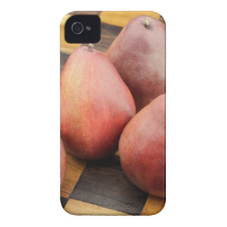 Five Red Pears on a Wooden Chessboard iPhone 4 Cover