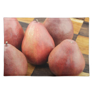 Five Red Pears on a Wooden Chessboard Placemat