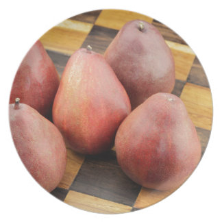 Five Red Pears on a Wooden Chessboard Plate