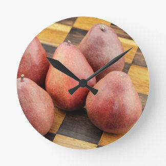 Five Red Pears on a Wooden Chessboard Round Clock