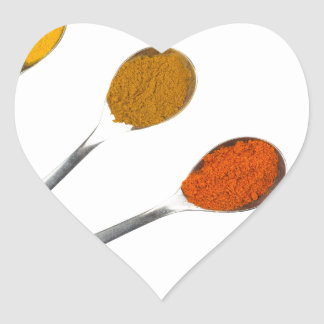 Five seasoning spices on metal spoons heart sticker