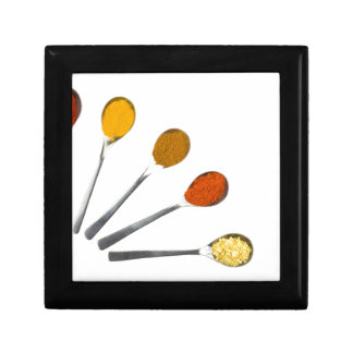 Five seasoning spices on metal spoons jewelry box