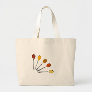 Five seasoning spices on metal spoons large tote bag