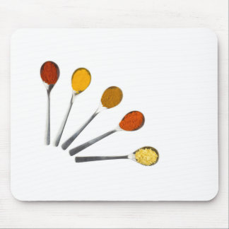 Five seasoning spices on metal spoons mouse pad
